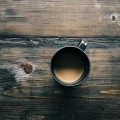 aerial-view-of-coffee-cup-on-wooden-table
